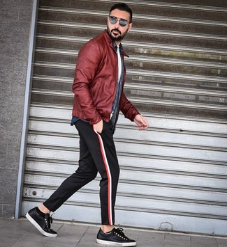 How to wear: burgundy leather bomber jacket, navy denim shirt, white crew-neck t-shirt, black chinos