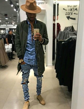 How To Wear a Denim Shirt With a Bomber Jacket In Spring For Men: If you're in search of a casual yet dapper look, reach for a bomber jacket and a denim shirt. Beige suede chelsea boots will give an elegant twist to an otherwise all-too-common look. This combo is a good idea when warmer days are here.