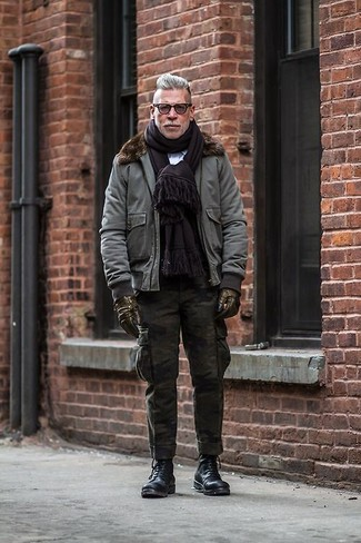 How to wear: grey bomber jacket, light blue dress shirt, olive camouflage cargo pants, black leather casual boots
