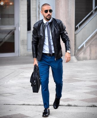 How to wear: black leather bomber jacket, white dress shirt, teal chinos, black leather double monks