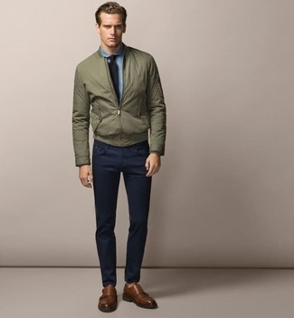 How to wear: olive bomber jacket, light blue chambray dress shirt, navy chinos, brown leather double monks