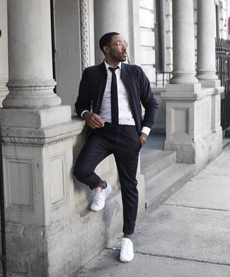 White Dress Shirt with Bomber Jacket Outfits For Men: For an ensemble that's worthy of a modern trendsetting guy and casually neat, team a bomber jacket with a white dress shirt. A pair of white canvas low top sneakers easily ups the style factor of your outfit.