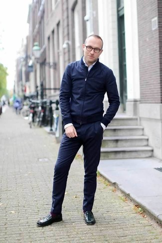 Which Bomber Jacket To Wear With Navy Dress Pants For Men: A bomber jacket and navy dress pants are absolute staples if you're putting together a polished wardrobe that holds to the highest sartorial standards. Add a pair of dark green leather loafers to your look to tie the whole look together.