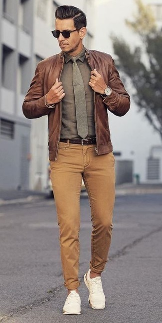 How to wear: brown leather bomber jacket, olive dress shirt, khaki corduroy jeans, white low top sneakers