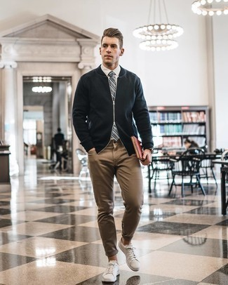 White Dress Shirt with Bomber Jacket Outfits For Men: You'll be amazed at how super easy it is for any gent to get dressed like this. Just a bomber jacket and a white dress shirt. Not sure how to finish? Complete this look with a pair of white leather low top sneakers to switch things up.