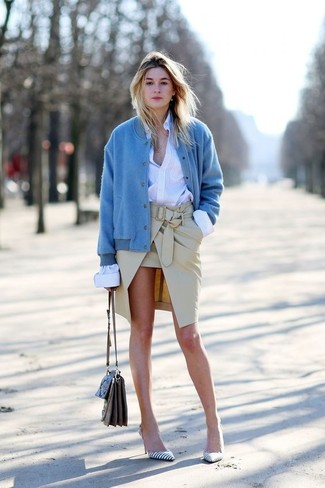 How to wear: blue bomber jacket, white dress shirt, beige pencil skirt, white and black horizontal striped leather pumps
