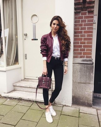 How to wear: burgundy bomber jacket, white dress shirt, black skinny jeans, white canvas low top sneakers