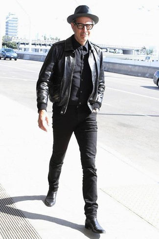 How to wear: black leather bomber jacket, black dress shirt, black skinny jeans, black leather chelsea boots