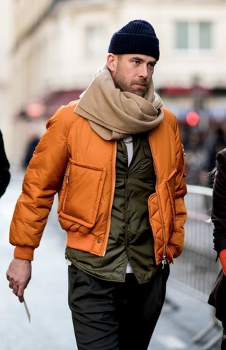 How to wear: orange bomber jacket, olive gilet, white crew-neck t-shirt, black chinos