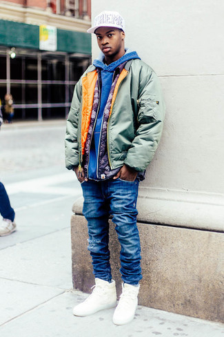 Bomber Jacket Outfits For Men: This street style combination of a bomber jacket and blue ripped jeans is extremely easy to put together without a second thought, helping you look dapper and ready for anything without spending too much time digging through your wardrobe. As for footwear, complete this getup with white canvas high top sneakers.