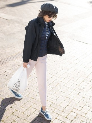 Consider pairing a gilet with pink tapered pants to achieve a chic look. Opt for a pair of blue canvas low top sneakers to make the getup current. This look is our idea of perfection for when leaves are falling down and temps are falling.