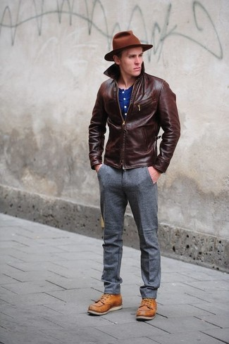 How to wear: dark brown leather bomber jacket, blue henley shirt, grey wool dress pants, tobacco leather casual boots