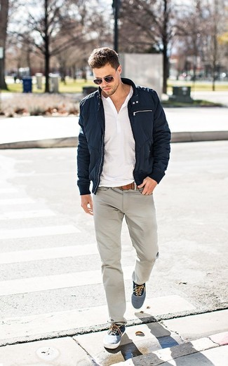 A henley shirt and grey jeans is a good combination worth integrating into your wardrobe. Grey plimsolls are a nice choice to complete the look.