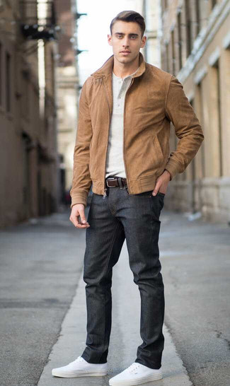 How to wear: brown suede bomber jacket, beige henley shirt, black jeans, white canvas low top sneakers