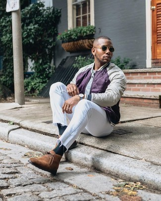 Brown Suede Desert Boots Outfits: Dress in a violet bomber jacket and white jeans to achieve an interesting and current laid-back ensemble. A pair of brown suede desert boots looks great here.