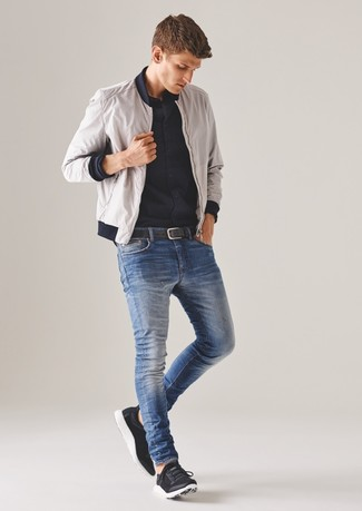 How to Wear a White Bomber Jacket In Your 30s For Men: The pairing of a white bomber jacket and blue skinny jeans makes for a solid laid-back getup. A pair of black athletic shoes instantly kicks up the street cred of this ensemble.