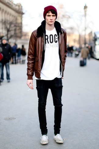 Nail off-duty dressing with this combination of a brown leather bomber and black destroyed slim jeans. A pair of white plimsolls will seamlessly integrate within a variety of outfits.