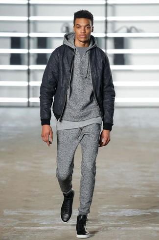 How to wear: black bomber jacket, grey hoodie, grey crew-neck t-shirt, grey sweatpants