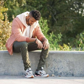 How to wear: pink bomber jacket, beige fleece hoodie, white crew-neck t-shirt, olive chinos