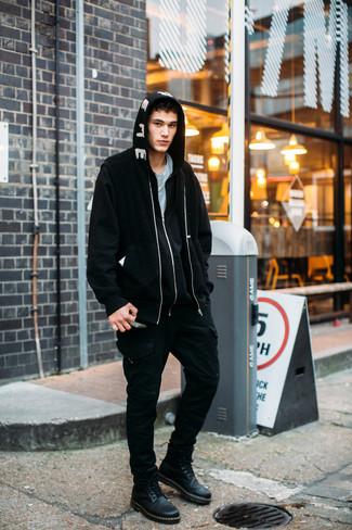 How to wear: black fleece bomber jacket, black and white print hoodie, light blue crew-neck t-shirt, black cargo pants