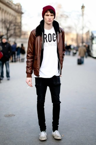 How to Wear a Tobacco Leather Bomber Jacket For Men: If you love relaxed dressing, why not team a tobacco leather bomber jacket with black ripped skinny jeans? If you wish to effortlesslly dress up this outfit with one single item, complement your look with a pair of white canvas low top sneakers.