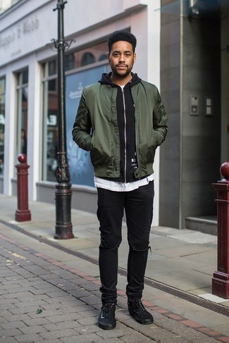 Men's Looks & Outfits: What To Wear In a Relaxed Way: For an off-duty outfit, try teaming a dark green bomber jacket with black ripped jeans — these two items fit perfectly well together. A pair of black canvas low top sneakers will take this look a classier path.