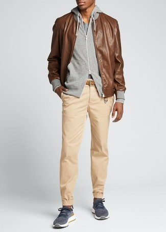 How to Wear Beige Chinos: This casual combo of a brown leather bomber jacket and beige chinos is a never-failing option when you need to look dapper in a flash. Rounding off with navy athletic shoes is a fail-safe way to infuse an easy-going vibe into your ensemble.