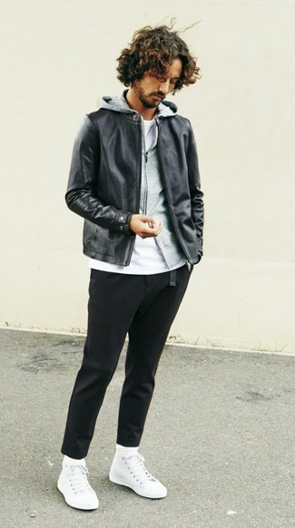 How to Wear a Black Leather Bomber Jacket For Men: A black leather bomber jacket and black chinos are veritable menswear staples if you're putting together an off-duty wardrobe that holds to the highest sartorial standards. And if you need to immediately dress down your outfit with a pair of shoes, why not add a pair of white canvas high top sneakers to the mix?