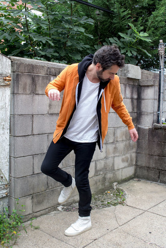 White Crew-neck T-shirt Outfits For Men: This pairing of a white crew-neck t-shirt and navy jeans is a safe go-to for a ridiculously dapper outfit. Jazz up this look by slipping into a pair of white canvas high top sneakers.