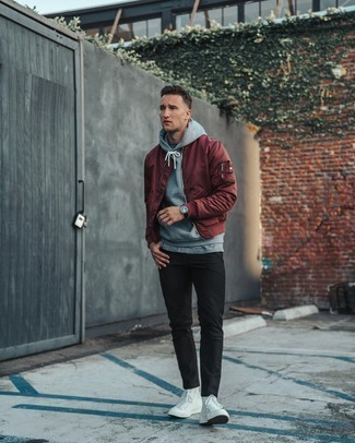 500+ Warm Weather Outfits For Men: This combination of a burgundy bomber jacket and black chinos makes for the ultimate casual outfit for any man. A pair of white canvas high top sneakers immediately boosts the wow factor of this look.