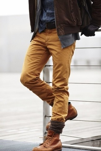 How to wear: brown leather bomber jacket, grey hoodie, navy denim shirt, khaki chinos