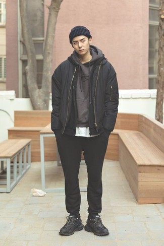 How To Wear Black Sneakers With a Black Sweater For Men: Rushed mornings call for a straightforward yet casually cool look, such as a black sweater and a black hoodie. And if you wish to easily play down your ensemble with a pair of shoes, why not complete this look with black sneakers?