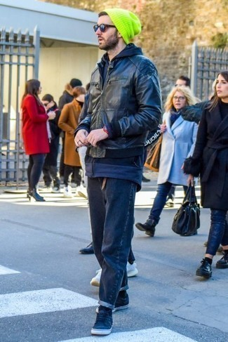 How To Wear a Black Leather Bomber Jacket With Navy Jeans For Men: This combo of a black leather bomber jacket and navy jeans will hallmark your expertise in men's fashion even on weekend days. Navy canvas low top sneakers will tie your full getup together.