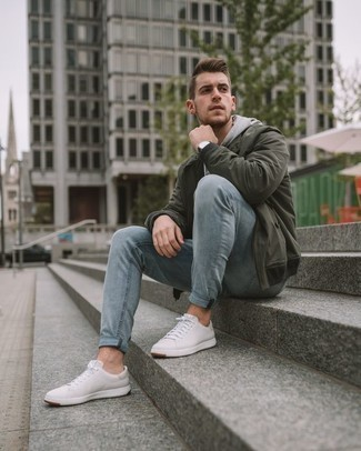 How to Wear a Dark Green Bomber Jacket For Men: This combo of a dark green bomber jacket and light blue jeans is simple, dapper and super easy to copy. Add a pair of white leather low top sneakers to this ensemble for extra style points.