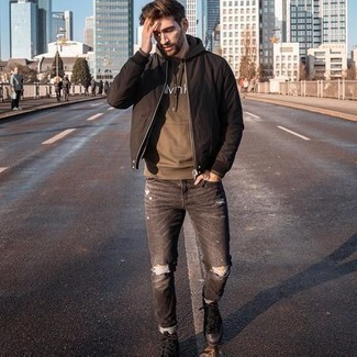 Tobacco Print Hoodie Outfits For Men: Choose a tobacco print hoodie and charcoal ripped jeans for a trendy and easy-going ensemble. On the shoe front, this outfit is completed really well with black leather work boots.