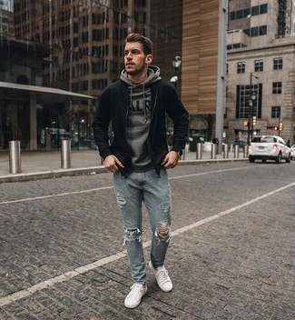 Grey Hoodie Outfits For Men: Demonstrate that you do off-duty like a pro in a grey hoodie and light blue ripped jeans. Give an elegant twist to this outfit by slipping into a pair of white canvas low top sneakers.