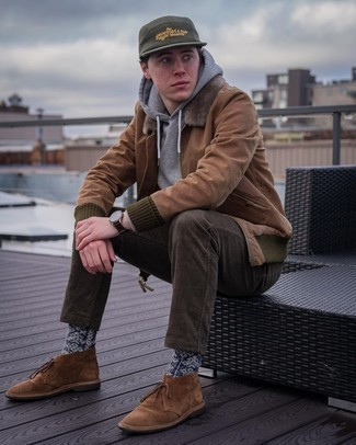 Olive Print Baseball Cap Outfits For Men: For comfort dressing with an edgy twist, consider wearing a brown bomber jacket and an olive print baseball cap. For extra fashion points, complement your outfit with a pair of brown suede desert boots.