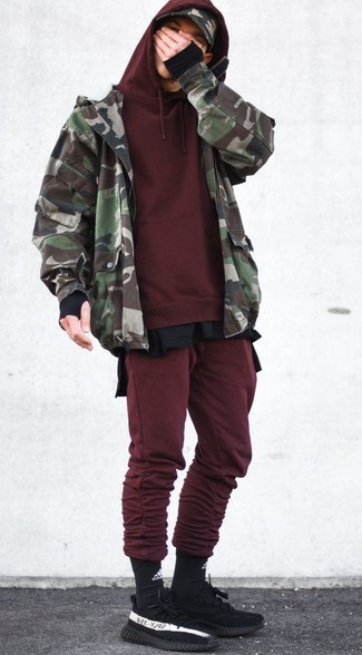 How to wear: olive camouflage bomber jacket, burgundy hoodie, black long sleeve t-shirt, burgundy sweatpants