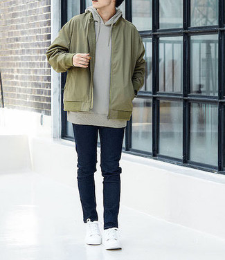 Navy Skinny Jeans Outfits For Men: This combination of an olive bomber jacket and navy skinny jeans will allow you to showcase your skills in men's fashion even on off-duty days. White canvas low top sneakers are a good idea to round off this outfit.