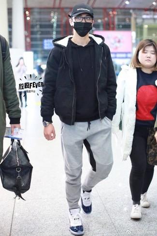 How to wear: black bomber jacket, black hoodie, grey sweatpants, white high top sneakers