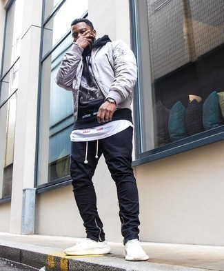 Grey Bomber Jacket Outfits For Men: Show off your chops in men's fashion by pairing a grey bomber jacket and black chinos for a laid-back look. A pair of white athletic shoes immediately ups the style factor of this ensemble.
