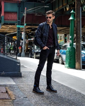 How to wear: navy bomber jacket, black long sleeve henley shirt, black jeans, black leather casual boots