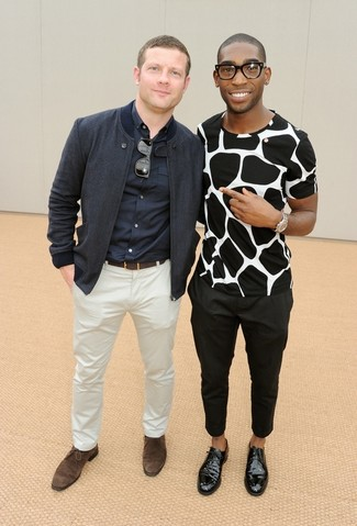 Dermot O'Leary wearing Navy Bomber Jacket, Navy Long Sleeve Shirt, White Chinos, Dark Brown Suede Derby Shoes