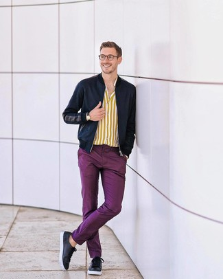 How to wear: navy bomber jacket, yellow vertical striped long sleeve shirt, purple chinos, black leather low top sneakers