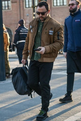 How to Wear a Brown Bomber Jacket For Men: This casual combination of a brown bomber jacket and black chinos is super easy to throw together without a second thought, helping you look on-trend and ready for anything without spending a ton of time digging through your closet. Tone down the dressiness of this outfit by sporting a pair of charcoal athletic shoes.