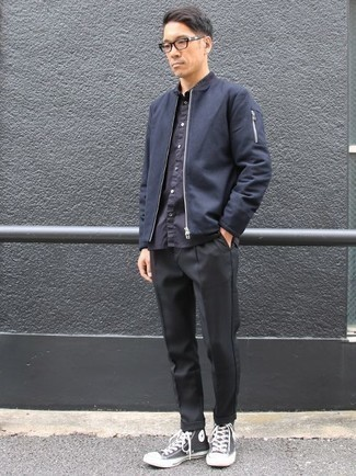 How to Wear Black Chinos: This pairing of a navy bomber jacket and black chinos is great for casual settings. Complete your outfit with a pair of black and white canvas high top sneakers to add a dose of stylish casualness to this ensemble.