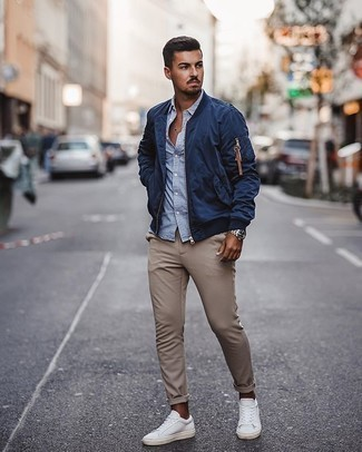 White and Blue Vertical Striped Long Sleeve Shirt Outfits For Men: A white and blue vertical striped long sleeve shirt and khaki chinos are great menswear staples that will integrate perfectly within your daily casual wardrobe. A pair of white canvas low top sneakers integrates perfectly within plenty of looks.