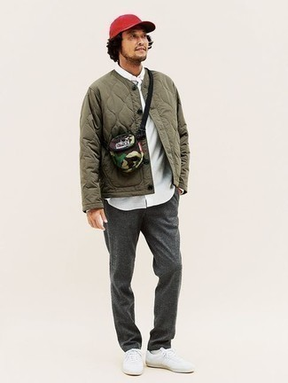 White Canvas Low Top Sneakers Outfits For Men: For a casually cool look, opt for an olive quilted bomber jacket and charcoal chinos — these pieces fit pretty good together. As for shoes, finish with white canvas low top sneakers.