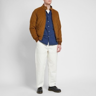 How to wear: tobacco suede bomber jacket, navy long sleeve shirt, white crew-neck t-shirt, white chinos