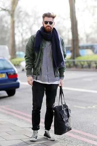 How to Wear a Navy Canvas Tote Bag For Men: Such items as a dark green bomber jacket and a navy canvas tote bag are the perfect way to introduce played down dapperness into your daily casual arsenal. Black and white canvas high top sneakers are guaranteed to breathe an added dose of refinement into this ensemble.